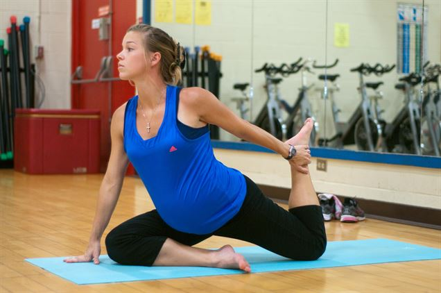 a pregnant woman doing a yoga pose