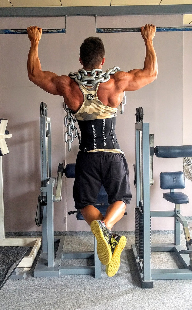 Rehabilitation from pain, a picture of a man doing pull ups